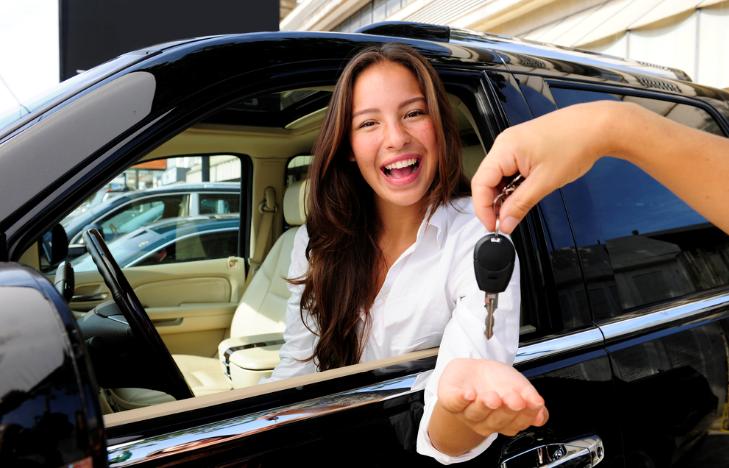Woman renting car