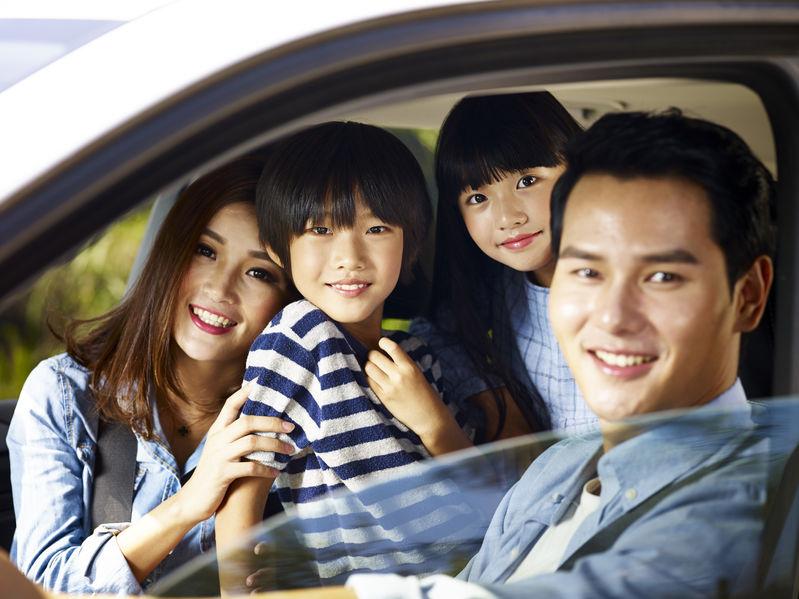 asian family enjoying a car ride